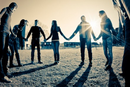 group-of-young-people-holding-hands-in-circle-e1357535577319